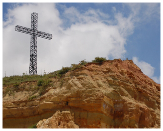 God showed His awesome power by raising Jesus from the dead. [Image: cross on a hill in Lebanon]